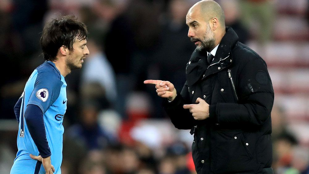 Manchester City coach Pep Guardiola lets David Silva know he was the man in the win over Sunderland. (AAP)