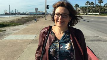 A Greek man has been detained for questioning in the slaying of American scientist Suzanne Eaton.