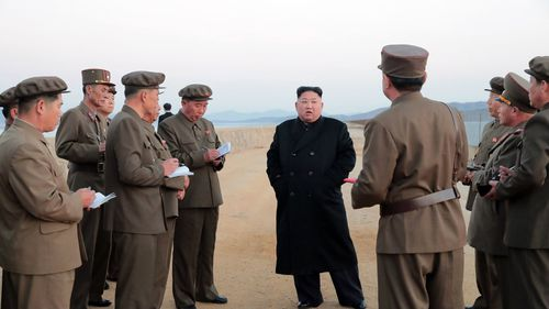 An undated photo released by North Korean state media today, showing North Korean dictator Kim Jong-Un with military officials.