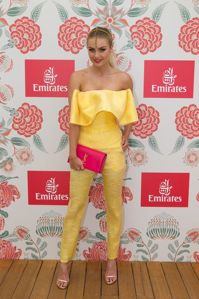 Model Elyse Knowles in Toni Maticevski jumpsuit, Suzy O'Rourke hats and YSL clutch.