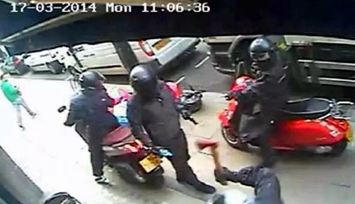 This CCTV image from 2014 shows axe-wielding moped robbers in London. (Metropolitan Police).