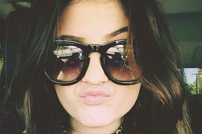 Kylie's early selfie look is more scrunchy than pouty.
