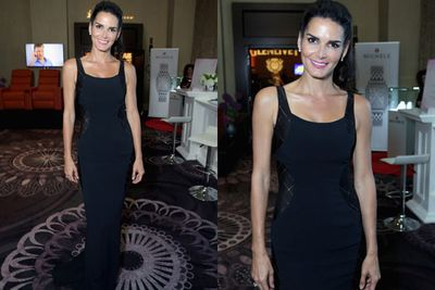 Angie Harmon shows off her super-slender bod in this figure-hugging navy number.