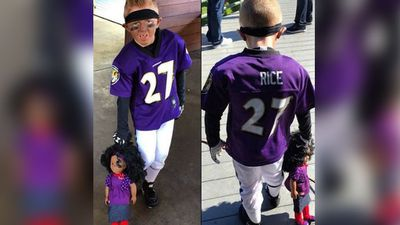 <b>Ray Rice:</b> An Instagram photo has surfaced of a child wearing a Ray Rice costume and dragging a doll, apparently to symbolise the wife of the embattled former NFL star, Janay Rice. Rice was cut from the Baltimore Ravens after video emerged of him punching his wife in an elevator. The photo has since been taken down from Instagram. (Picture: Instagram)