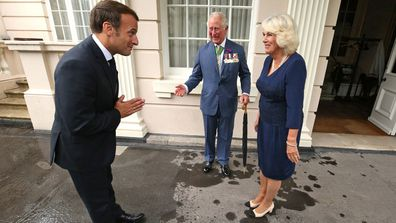 Prince Charles, Prince of Wales and Camilla, Duchess of Cornwall greet French President Emmanuel Macron with a namaste gesture as he arrives at Clarence House on June 18, 2020 in London, England