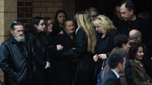Loved ones of Courtney Herron at St Dimitrios Greek Orthodox Church this morning.