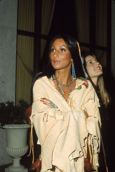During decades of stardom Cher has had many hairdo and hair don't but her signature look remains ramrod straight locks, as seen on <em>The Sonny & Cher Show</em> in the '70s. Here the singer works a Pocahontas vibe in 1973.