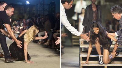 Two models stumble on the Givenchy runway. (AAP)