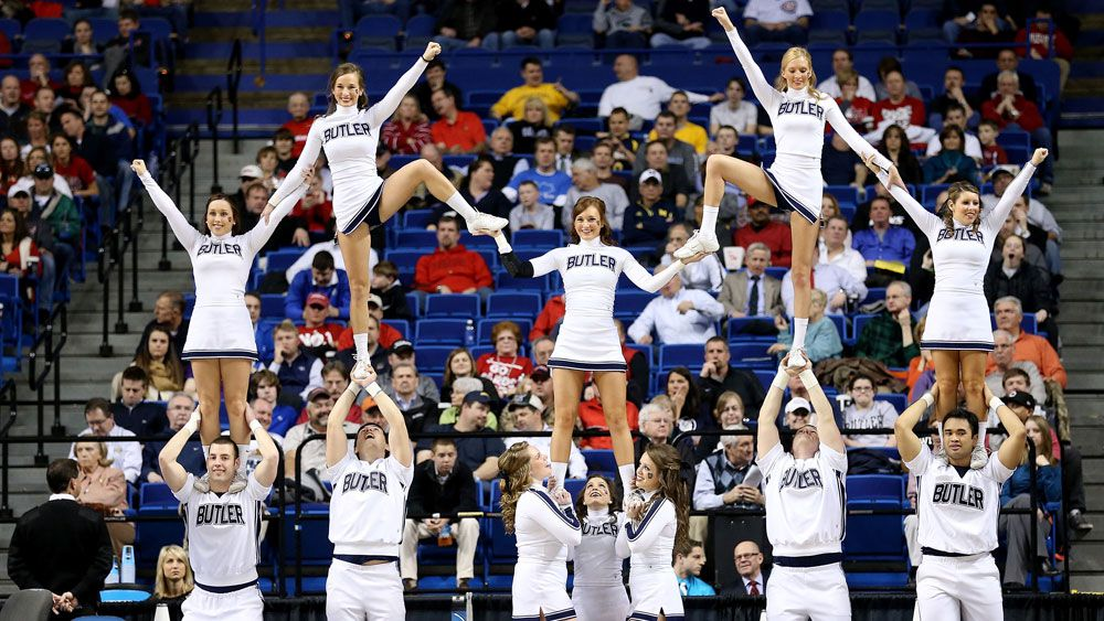A college cheerleading squad goes through its routine. (AFP)