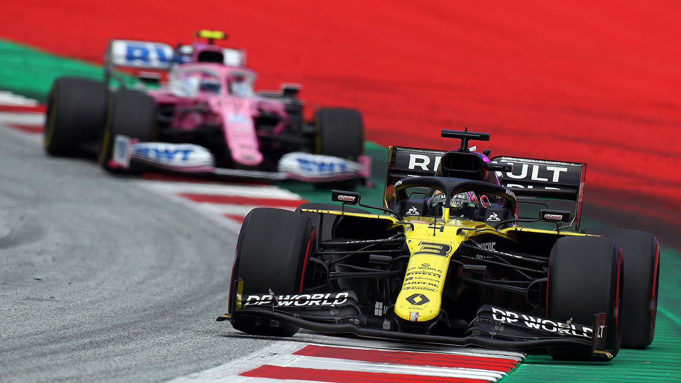 Daniel Ricciardo's Renault leads Lance Stroll in the Racing Point during the Styrian Grand Prix.