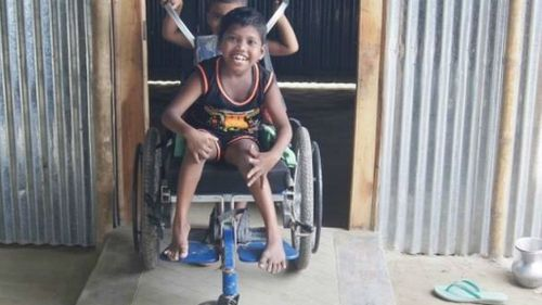 A child in Bangladesh on a wheelchair delivered last year. (Facebook/Wheelchairs for Kids)