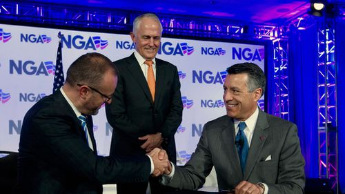 Australian Chief Minister Andrew Barr, left, shake hands with National Governors Association (NGA) Chair, Governor Brian Sandoval of Nevada. (AAP)