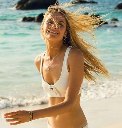 Model Bridget Malcolm on beach
