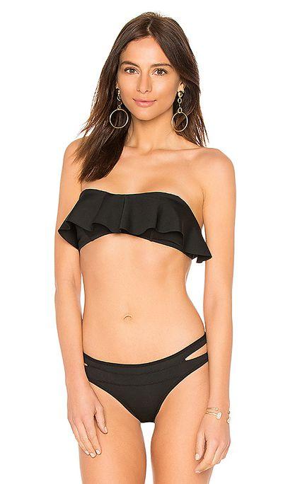 "<p><a href=""http://www.revolveclothing.com.au/kendall-kylie-ruffle-bandeau-bikini-top/dp/KENR-WX53/?d=Womens&amp;page=1&amp;lc=45&amp;itrownum=15&amp;itcurrpage=1&amp;itview=01"" target=""_blank"">Ruffle Bandeau Bikini top</a>,&nbsp;$126.21, and <a href=""http://www.revolveclothing.com.au/kendall-kylie-ruffle-bandeau-bikini-top/dp/KENR-WX53/?d=Womens&amp;page=1&amp;lc=45&amp;itrownum=15&amp;itcurrpage=1&amp;itview=01"" target=""_blank"">bottoms</a>, $41.21</p>"