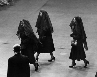 Queen Elizabeth the Queen Mother, Queen Elizabeth II and Princess Margaret Rose arrive for King George VI's funeral