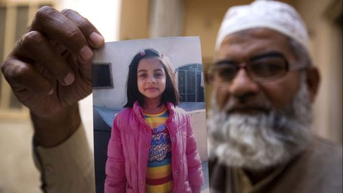 Victim Zainab Ansari in a photo held up by her father