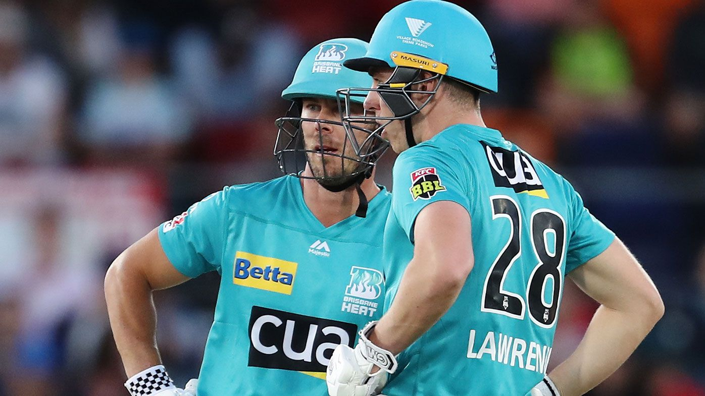 Chris Lynn and Dan Lawrence of the Heat chat during the Big Bash League match between the Sydney Thunder and the Brisbane Heat at Manuka Oval, on December 14, 2020, in Canberra, Australia.