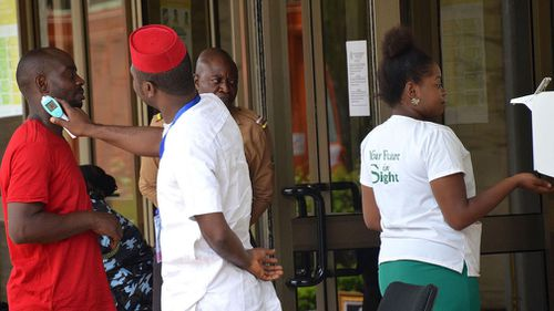 Visitors are screened for the Ebola virus at the Economic Community of West African States (ECOWAS) Parliament secretariat in Nigeria. Picture: EPA