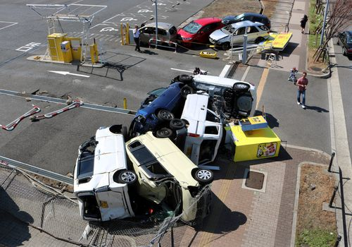 A view of tumbled cars following strong winds caused by powerful typhoon Jebi, in Osaka, Osaka Prefecture, western Japan