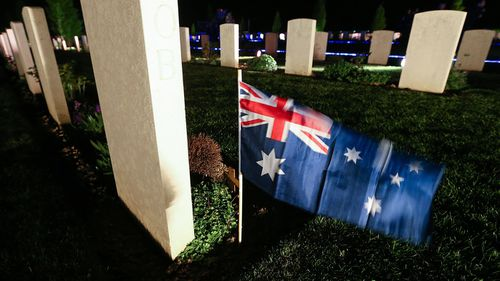 An Australian flag by the tomb of a soldier at the Australian military cemetery.