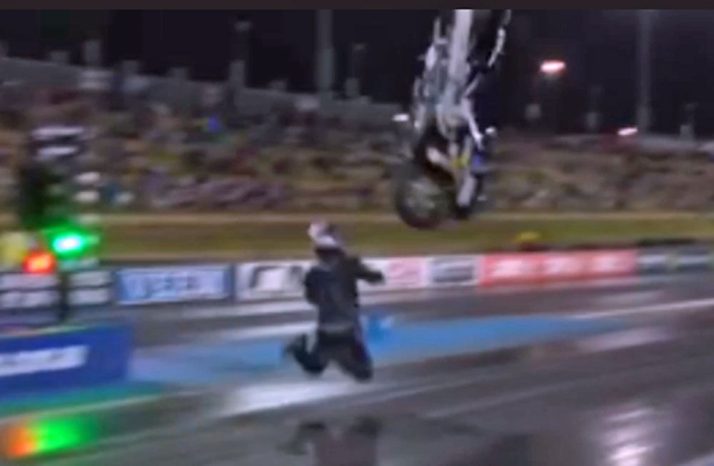 Drag racer sent flying as bike flips