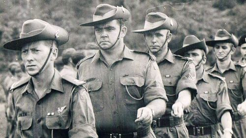 Major Harry Smith, CSM Jack Kirby and Sergeant Bob Buick take part in a medal ribbon parade in January 1967. (Australian War Memorial)