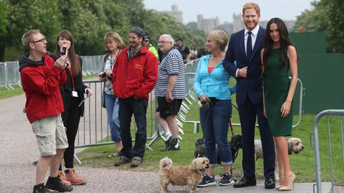 Meghan and Harry wax figures tour Windsor ahead of the big day. (Getty)