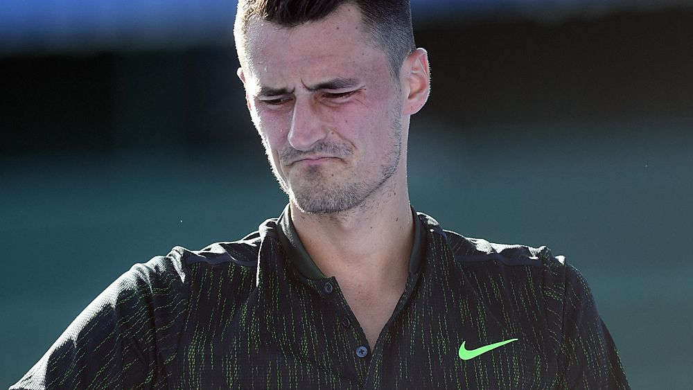Tomic loses Open qualifying warm-up