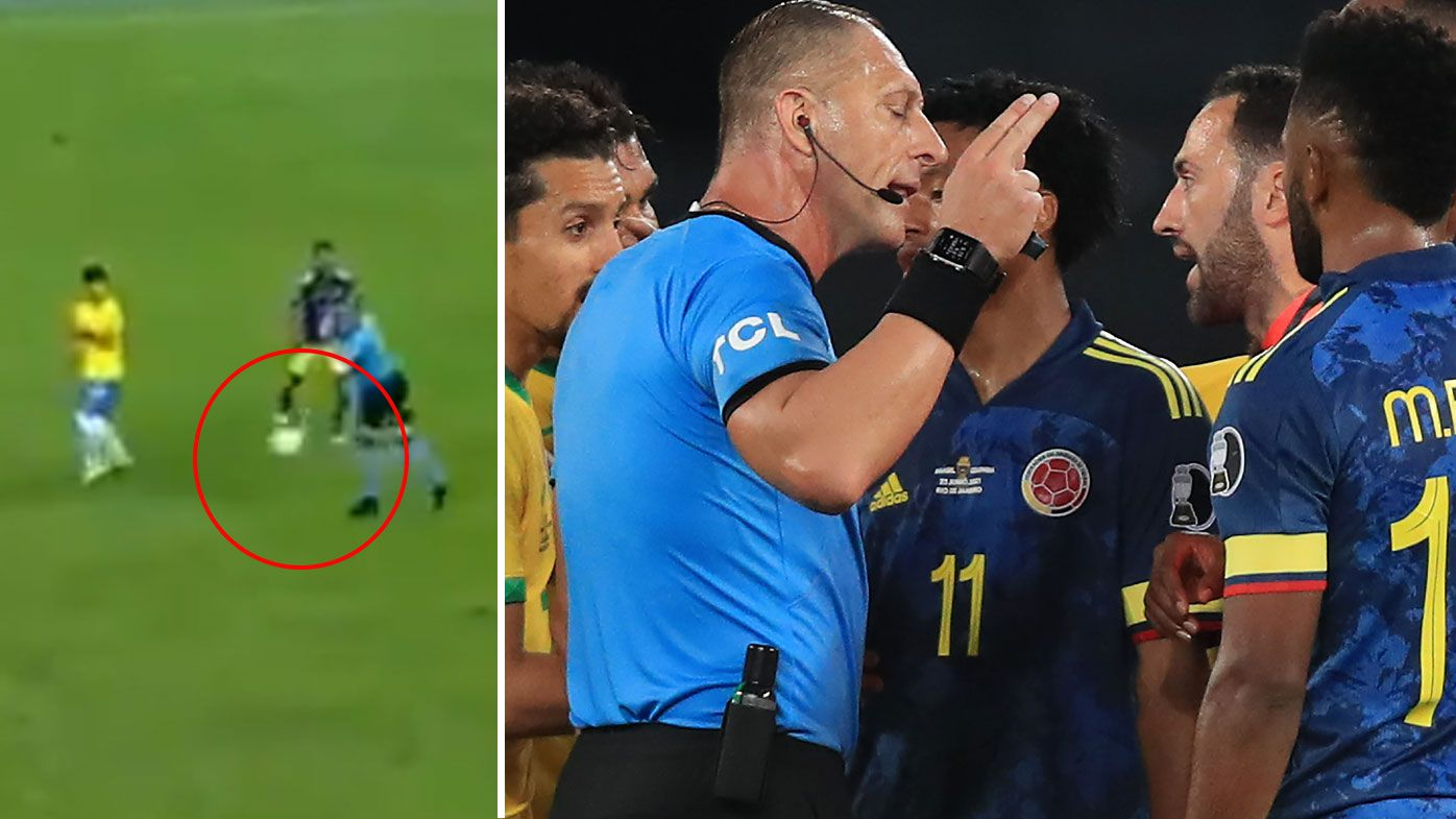 Colombia protest with referee Pitana after his interference led to a goal for Brazil.