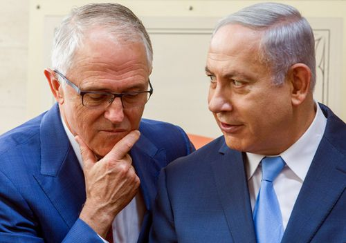 Former Australian Prime Minister Malcolm Turnbull and Israeli Prime Minister Benjamin Netanyahu chat at the opening of an ANZAC museum in the memorial for the fallen in the Battle of Beersheba during a ceremony marking the 100th anniversary of the battle