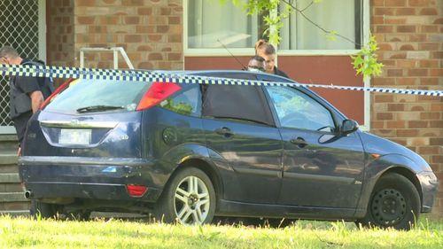 AFP Forensic investigators search for evidence at the Narrabundah home.