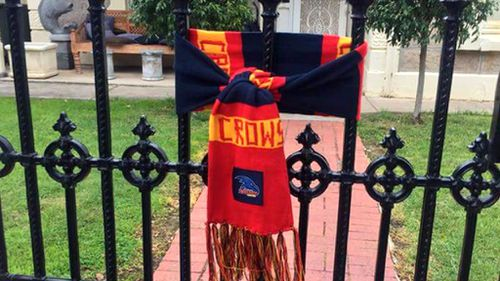 Distraught Crows fans declare #weflyasone with scarves and guernseys tribute