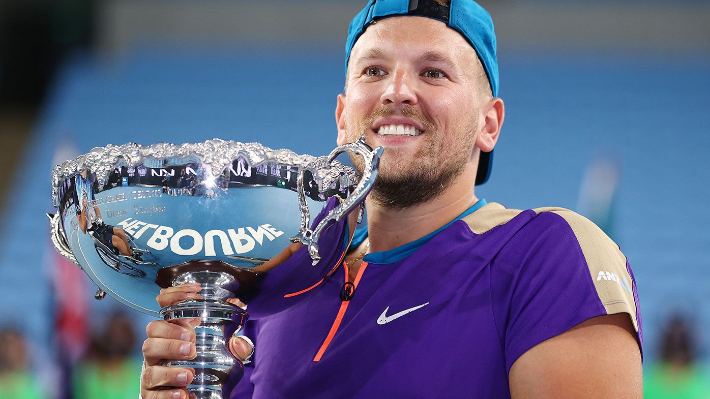 Dylan Alcott of Australia poses with the championship trophy after winning his Quad Wheelchair Singles Final match against Sam Schroder of the Netherlands