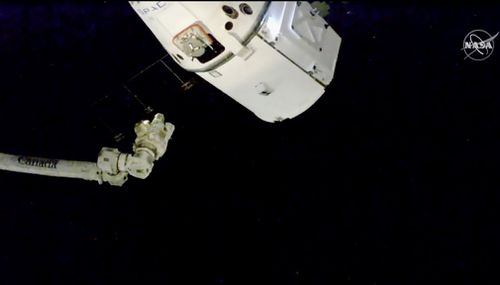 A capsule containing Christmas treats including smoked turkey and fruitcake has arrived at the International Space Station.