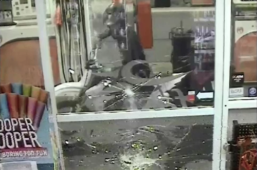 Police allege the two suspects smashed the service station window before attacking the worker with a hammer.