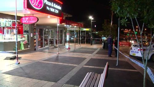 The man was standing with a group of people on the footpath when the attack occurred. (9NEWS)