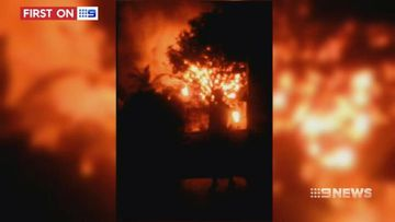 VIDEO: Brisbane woman escapes as home goes up in flames
