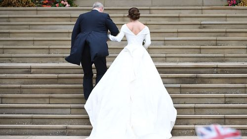 The bride's dress featured wide fold-over shoulders, a low back and full-flowing train, was by Peter Pilotto and Christopher De Vos.