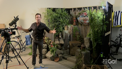 Jeff Probst in his house showing off where he will announce the winner of Survivor Winners at War.