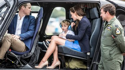 Prince George and his parents took a close look at the RAF Squirrel helicopter that his father Prince William trained in in 2009.