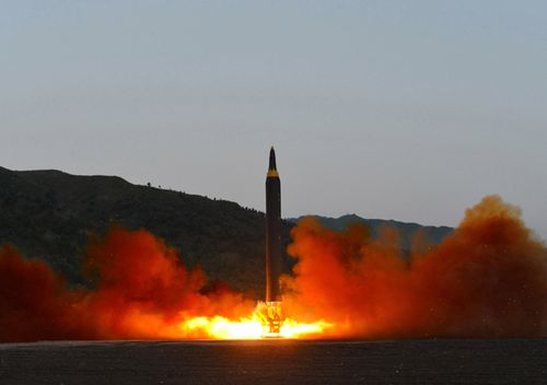 An undated photo released 15 May 2017 by North Korean Central News Agency (KCNA) showing the test-firing of a new ground-to-ground medium long-range strategic ballistic rocket Hwasong-12 on 14 May 2017.