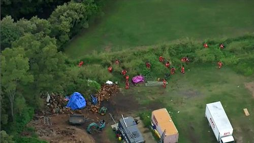 A crime scene has been set up in Brisbane's north, with SES crews currently combing the area.