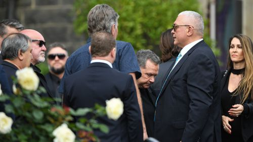 Melbourne identity Mick Gatto farewells his son, Justin.