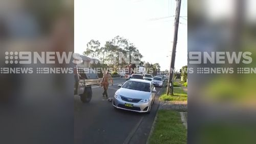 The bizarre road rage attack was captured on video on the Horsley Drive in Fairfield yesterday. (9NEWS)