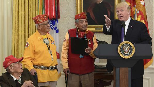 President Donald Trump with a few of the last remaining Navajo code-talkers. (AAP)