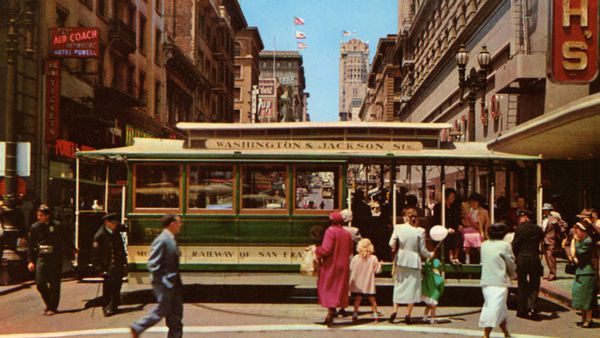 Vintage postcard showing a cable car on the turntable in downtown San Francisco.
