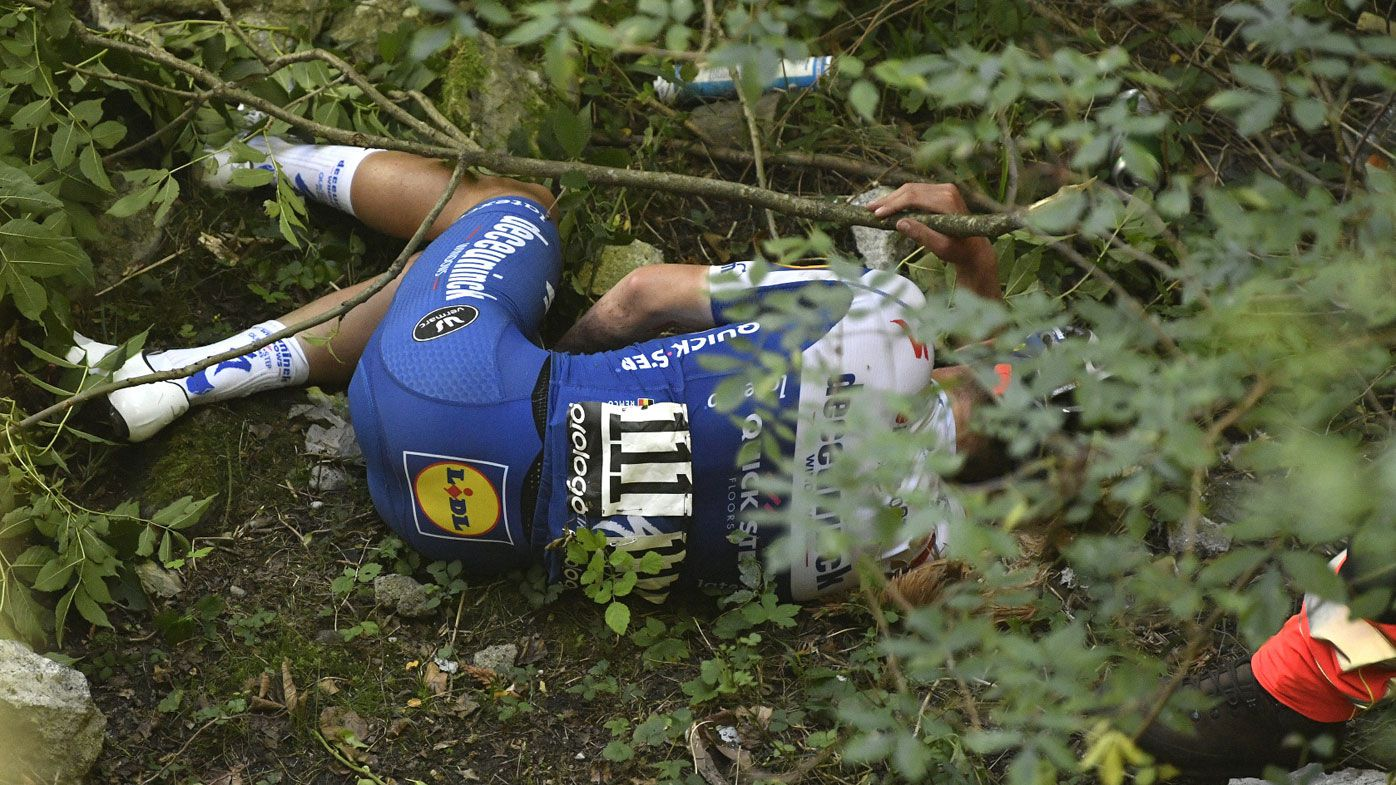 Remco Evenepoel crashes off bridge during Tour of Lombardy one-day cycling classic