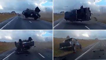 Car flips across busy highway