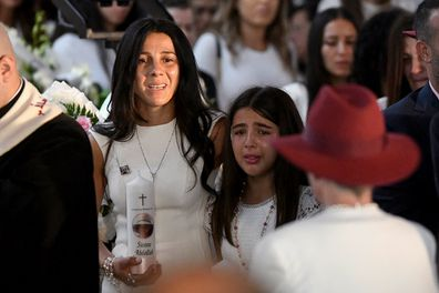 Mother Leila Geagea (left) and her daughter are seen entering the church for the funeral.
