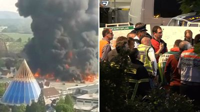 Theme park evacuated as fire rages